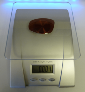Alutra lens on the scales