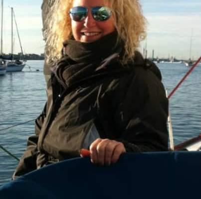 A lady on a sailing boat wearing Bigatmo sunglasses