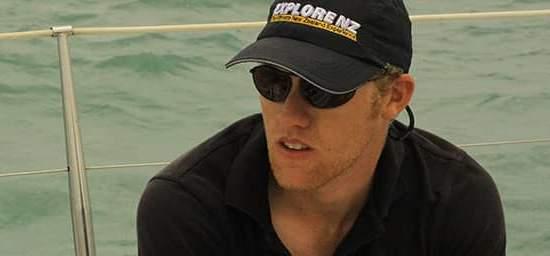 Man sitting on a boat wearing Bigatmo sunglasses-Polarized-lens and a baseball cap