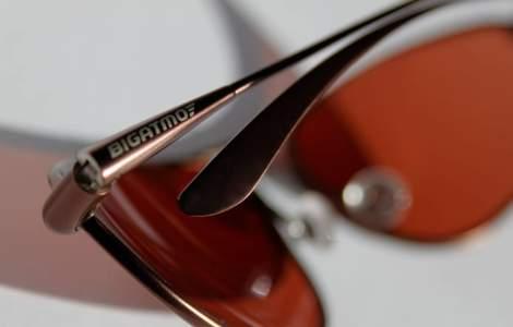 Folded sunglasses showing Bigatmo logo on temple arm