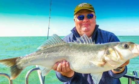 Peter out fishing wearing his Bigatmo polarized sunglasses, holding the catch of the day.