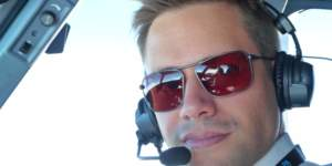 Commercial pilot wearing Bigatmo Iono photochromic sunglasses with ANR headset