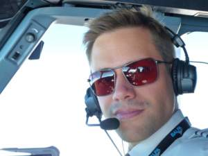 Commercial pilot wearing Bigatmo Iono photochromic sunglasses with ANR headset.