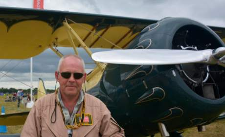 Nigel wearing Strato 0181, standing next to his airplane