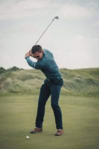Golfer taking a swing at the ball