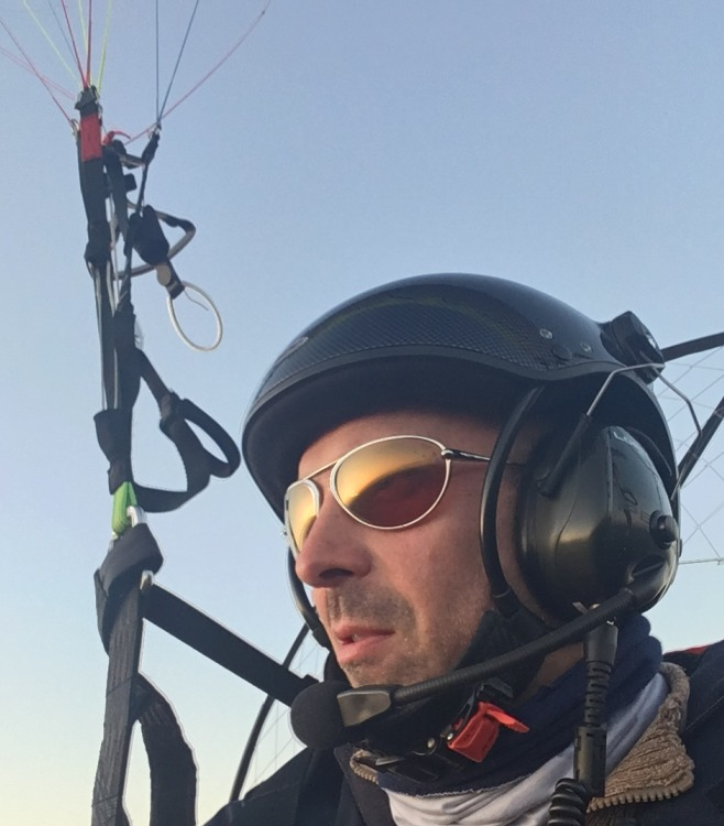 Man wearing Bigatmo sunglasses whilst power paragliding