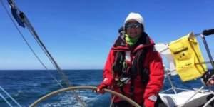 Jane Eldridge at the helm of her sailing yacht, wearing bigatmo sunglasses and sailing gear.