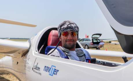 Jake Brattle wearing Bigatmo sunglasses and sitting in his glider before racing in France.